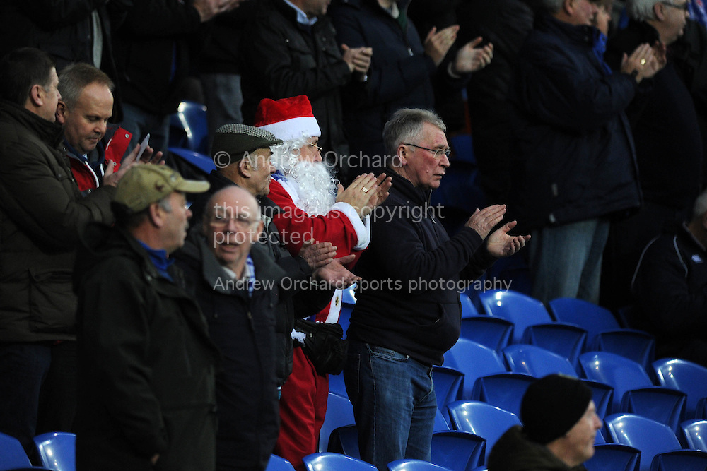 a Cardiff fan dressed as Father Christmas claps the teams ahead of the match. Skybet football league championship match, Cardiff city v Sheffield Wednesday at the Cardiff city stadium in Cardiff, South Wales on Saturday 12th December 2015.<br /> pic by Andrew Orchard, Andrew Orchard sports photography.