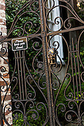 Decorative iron gates with sign at a historic home in Charleston, SC.