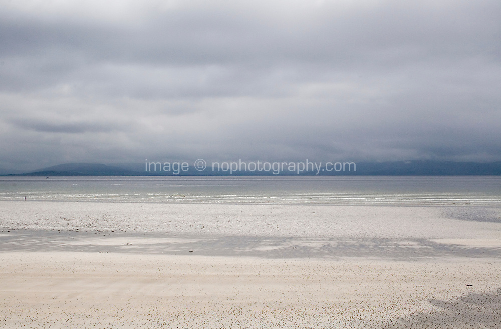 Low tide on a quiet beach near Bearna Galway in Ireland