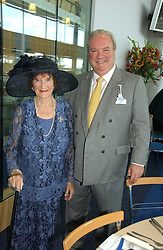 RORY MORE O'FERRALL the director of external affairs at De Beers and his mother MRS GEORGE MORE O'FERRAL at the King George VI and The Queen Elizabeth Diamond Stakes sponsored by De Beers for the 35th year held at Ascot Racecourse, Berkshire on July 29th 2006.    De Beers hosted a lunch before the races for about 250 people.<br />