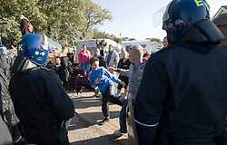 © Licensed to London News Pictures. 19/10/2011. Crays Hill, UK. Travellers watch as bailiffs and police enter the Dale Farm travellers site. Residents at Dale Farm, the UK's largest illegal traveller site being evicted today (19/10/2011) following a long dispute with Basildon Council . Travellers and activist had barricaded themselves in to the site in an attempt to prevent their eviction. Photo credit: Ben Cawthra/LNP