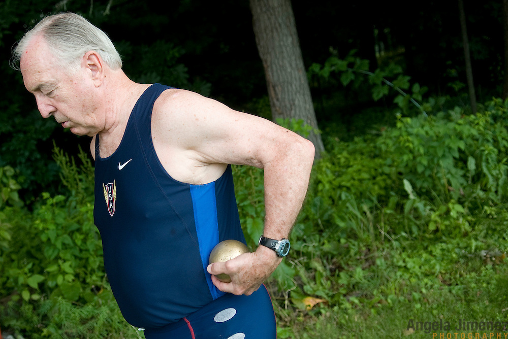 Date: 6/27/09.Desk: NAT.Slug: aging$500.Assign Id: 30081997A..Jim Duncan, 76, unattached of Woodbury, Connecticut, competes in the shot put at the 2009 USATF (USA Track & Field) East Region Masters Track & Field Championships at East Stroudsburg University in East Stroudsburg, Pennsylvania on June 27, 2009....Photo by Angela Jimenez for The New York Times .photographer contact 917-586-0916