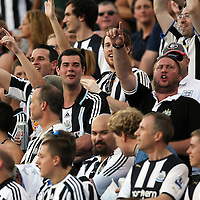 Newcastle United fans chant during an International Friendly soccer match between English Premier League team Newcastle United and the Orlando City Lions of the United Soccer League, at the Florida Citrus Bowl on Saturday, July 23, 2011 in Orlando, Florida. Orlando won the match 1-0. (AP Photo/Alex Menendez)