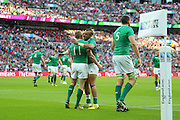 Ireland's Keith Earls is congratulated after his try during the Rugby World Cup Pool D match between Ireland and Romania at Wembley Stadium, London, England on 27 September 2015. Photo by Phil Duncan.