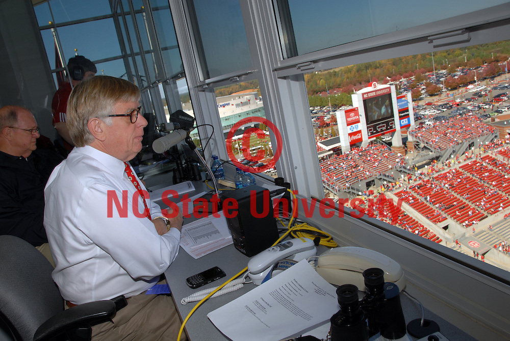 Football game announcer Dr. Ed Funkhouser waits for the kick-off in Carter-Finley Stadium. PHOTO BY ROGER WINSTEAD
