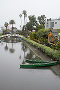 Photo Venice Canal wall art. Rainy day landscape, green canoes, a bridge and palm trees water reflections. Los Angeles, Westside, Southern California landscape photography. Matted print, limited edition. Fine art photography print.