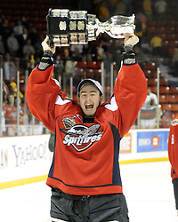 Philipp Grubauer hoists the Memorial Cup after the Windsor Spitfires defeated the Brandon Wheat Kings in the championship game at the 2010 MasterCard Memorial Cup in Brandon, MB on Sunday May 23. Photo by Aaron Bell/CHL Images