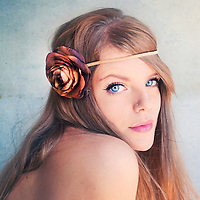 Close up of young woman with blonde hair and floral headband