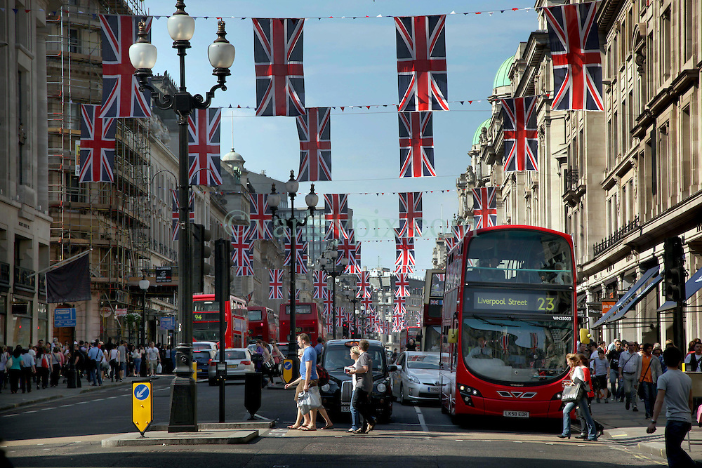 22 April 2011. London, England..London's Regent Street decked out with Union Jack flags  to celebrate the upcoming Royal wedding in the heart of London's West End. Thousands of tourists are packing the shops, hotels and restaurants as the big day draws near. .Photo; Charlie Varley.