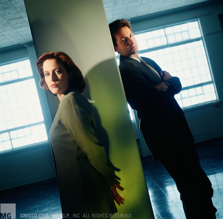VANCOUVER - MARCH 10 :  Actors Gillian Anderson and David Duchovne pose for a photo on the set of the television show X-Files on March 10, 1995 in Vancouver, Canada. (Photo by Michael Grecco)
