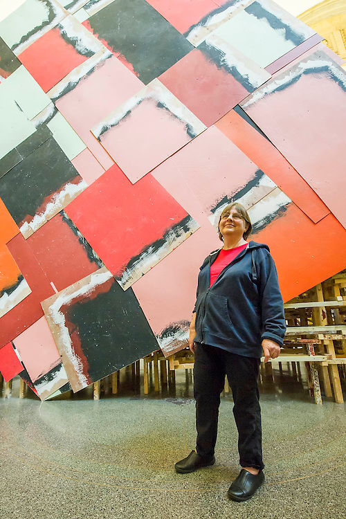 Phyllida Barlow's (pictured in blue hoodie) new work 'dock' is the new installation, which fills Tate Britain's Duveen Galleries.  Here untitled:dock:huge container. It has been created as part of the annual Tate Britain Commission, in which a leading contemporary artist is invited to develop a work inspired by Tate's Collection. Phyllida Barlow has worked for over four decades with inexpensive, everyday materials to create large sculptural installations and bold and colourful three-dimensional collages. Tate Britain, Millbank, London, UK 31 March 2014.   Guy Bell Photography, 07771 786236, guy@gbphotos.com