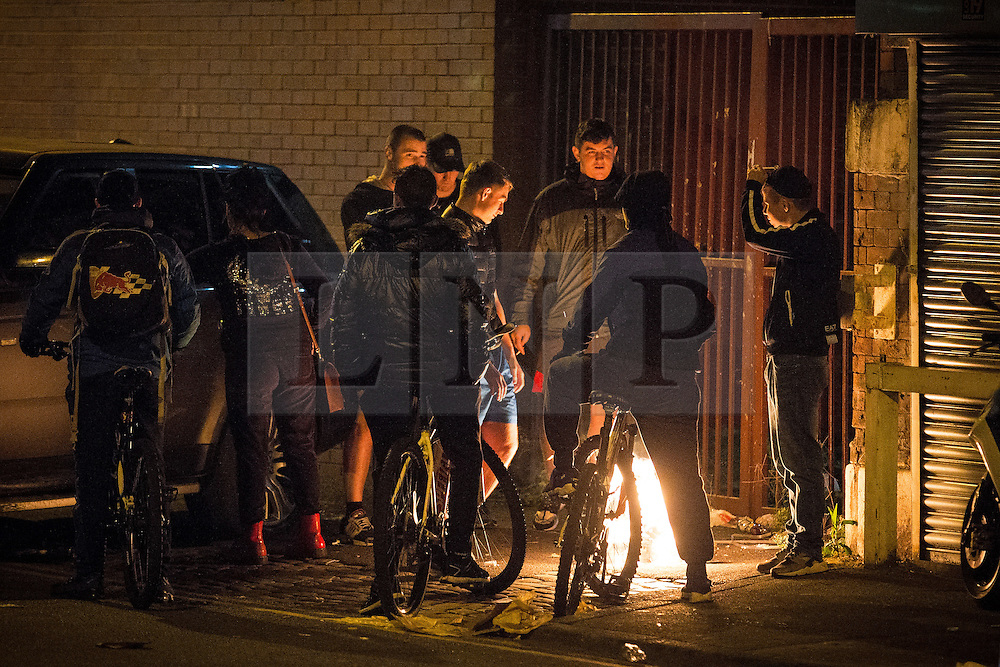 © Licensed to London News Pictures . 15/09/2015. Manchester, UK . A fire is lit off Bury New Road , outside HMP Manchester (formerly Strangeways Prison ) where protesters are blocking the road , playing music and dancing in the road as Stuart Horner continues his protest on the roof of HMP Manchester . Photo credit : Joel Goodman/LNP