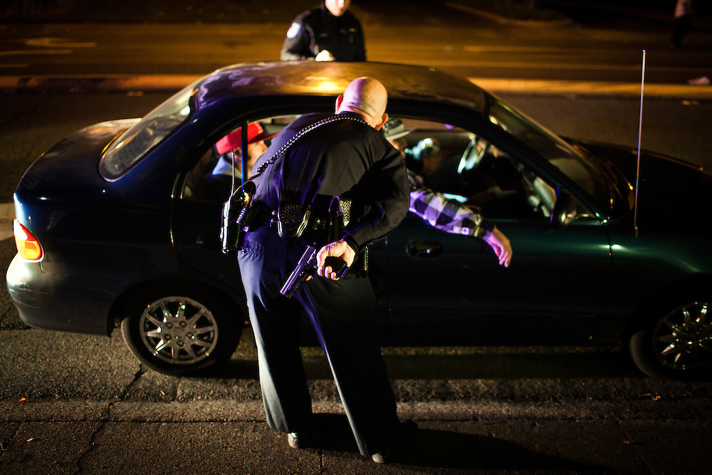 Former Sacramento Police Department robbery detective Darryl Bryan unholsters his gun during a traffic stop as a patrol officer on the graveyard shift on October 26, 2012 in Sacramento, Calif. Budget cuts have decimated the Sacramento Police Department resulting in the elimination of many investigative units.