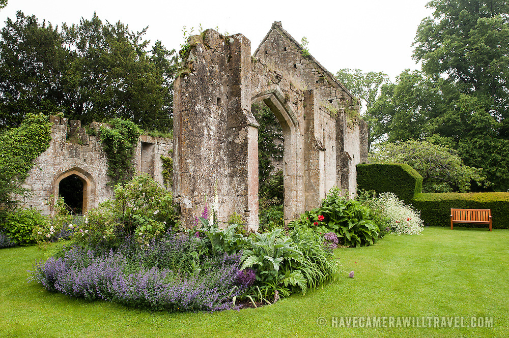 The Tithe Barn at Sudeley Castle. Now mostly in ruins, it was built in the 15th century as a manorial barn, then became a store for parish tithes before being partly destroyed in the Civil War. Roses from around the world grow amongs the ruins. Sudeley Castle dates back to the 15th century, although an even older castle might have once been on the same site. It was the final home and burial place of King Henry VIII's last wife, Queen Catherine Parr (c. 1512-1548).