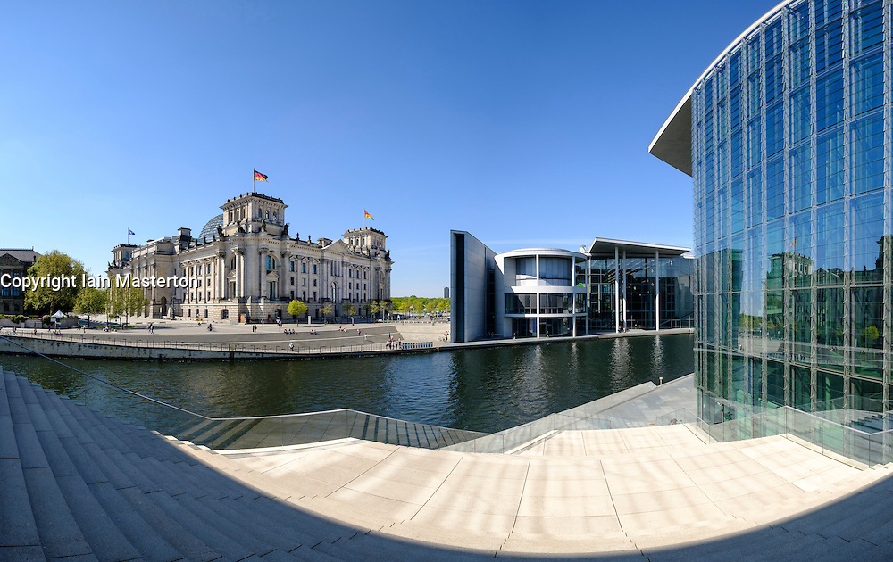 View of The Reichstag parliament building, Paul Lobe Haus and Marie Elisabeth Luders ( Lueders) Haus government buildings beside River Spree in Berlin Germany