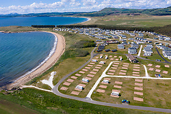Aerial view of empty caravan pitches at Elie Holiday Park on Shell bay near Elie in Fife. The park would normally be busy at this time year but is closed due to the Covid-19 pandemic.
