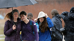 Wendy Morris and her daughter, Angel Long, 17, a junior at Great Mills High School, leave the James A. Forrest Career and Technology Center on Tuesday, March 20, 2018, after they were reunited. Great Mills students were evacuated after a suspected shooter was killed by a school resource officer. Two students were injured. Photo by Kim Hairston/Baltimore Sun/TNS/ABACAPRESS.COM