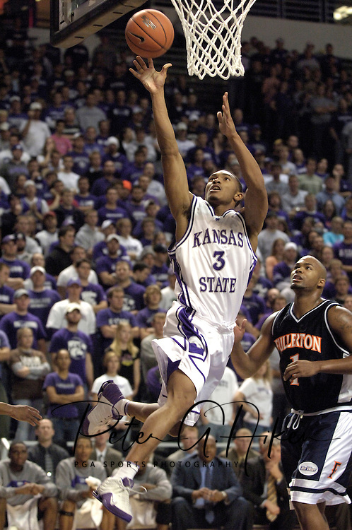 Kansas State guard Lance Harris (3) dirves and scores past Cal State Fullerton's Jamaal Brown (1) during the second half of the Wildcats 84-59 win at Bramlage Coliseum in Manhattan, Kansas, November 30, 2005.