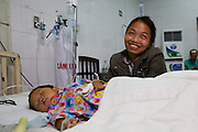 21, Bui Van Danh with mother Ai in the recovery room following surgery.<br /> <br /> 25th Anniversary of Operation Smile in Vietnam mission November 15th - 23rd 2014.  Vietnam Cuba Friendship Hospital. Hanoi. Vietnam.<br /> <br /> (Operation Smile Photo - Zute Lightfoot)