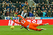 Aaron Ramsdale (#12) of AFC Bournemouth stretches to deny Miguel Almiron (#24) of Newcastle United during the Premier League match between Newcastle United and Bournemouth at St. James's Park, Newcastle, England on 9 November 2019.