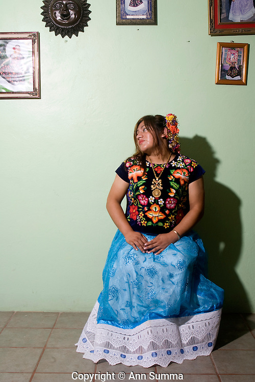 """Juchitan, Mexico:   """"La Luz de la Luna,"""" Biani Bew Marcelino, or Marci, is a muxe, or transvestite, living in the Oaxacan town of Juchitan. Here she dresses in her aunt's traditional, richly embroidered, Tejuana huipil and modernized skirt.  Muxes are very common, and accepted, in this Southern Oaxacan region, which claims to not discriminate against gays. The matriarchal society is still driven by women but in flux in the machismo culture of Mexico. Sept 15, 2008. (photo: Ann Summa)."""