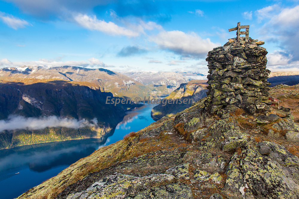 View from the mountain Prest above Aurland towards the Aurlandsfjord. <br /> <br /> The small Norway in a nutshell ship down on the fjord.