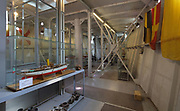 Onboard Museum, opened 2002, with models of warships belonging to Duke Amedeo d'Aosta, inside the Regia Nave Puglia, a warship, set into the Mastio hill, at Vittoriale degli italiani, or The Shrine of Italian Victories, the home, estate and museums of Gabriele D'Annunzio, 1863-1938, Italian writer, soldier and fascist, at Gardone Riviera, Lake Garda, Brescia, Lombardy, Italy. The ship was a gift from Admiral Thaon di Revel in 1923, in memory of captain Tommaso Gulli, who died in the waters of Split in 1920. The estate consists of the Prioria, where d'Annunzio lived 1922-38, an amphitheatre, the protected cruiser Puglia, the MAS vessel used by D'Annunzio in 1918 and a mausoleum. It is part of the Grandi Giardini Italiani. Picture by Manuel Cohen