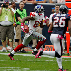 October 10, 2010; Houston, TX USA; New York Giants wide receiver Hakeem Nicks (88) runs for a touchdown as Houston Texans safety Eugene Wilson (26) and defensive back Kareem Jackson (25) pursue the play during the first half at Reliant Stadium. Mandatory Credit: Derick E. Hingle