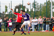 City of Liverpool's (purple) Jamie McDonald and   Litherland's Chris Lowe (Red) during the North West Counties League Play Off Final match between Litherland REMYCA and City of Liverpool FC at Litherland Sports Park, Litherland, United Kingdom on 13 May 2017. Photo by Craig Galloway.