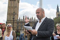 "Westminster, London, May 24th 2016. Animal rights protesters from ""Boycott Dogs4Us"" protest outside Parliament against puppy farming and third party puppy selling as the Environment, Food and Rural Affairs Sub-Committee are investigating the sale of dogs as part of their animal welfare inquiry. PICTURED: TV Vet Marc Abraham addresses the crowd"