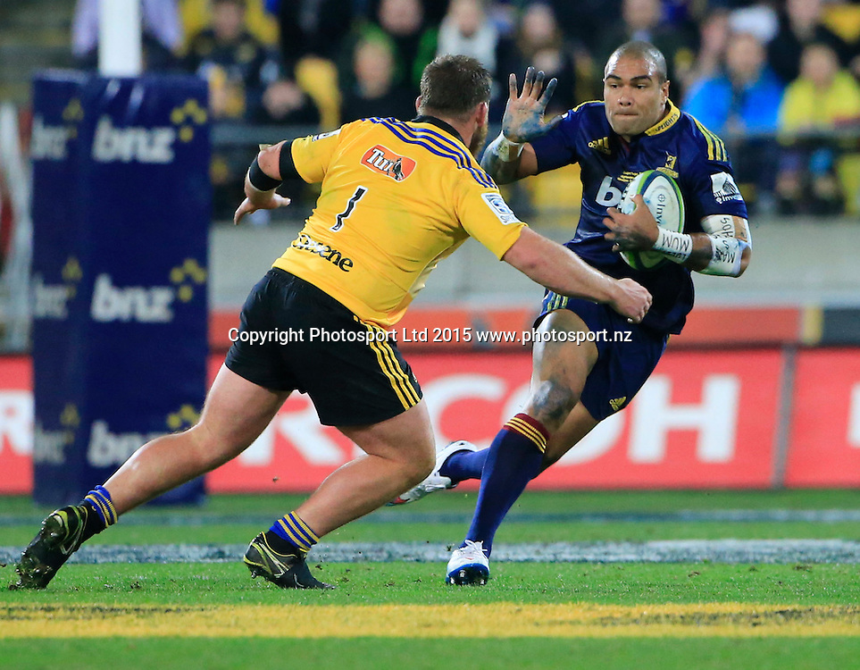 Patrick Osborne fends a tackle by Reggie Goodes. Super Rugby Final, Hurricanes v Highlanders. Westpac Stadium, Wellington, New Zealand. 4 July 2015. Copyright Photo: John Cowpland / www.photosport.nz