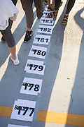 Participants in the Bobcathon Cake Walk stand on or near numbered spaces before the start of the cake walk on October 5, 2016. When a number was called, the person standing on that space won a cake.