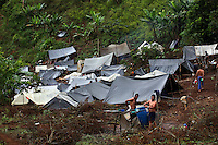 Workers hired by the Colombian government to manually eradicate coca crops wash in their camp after a long day of work, in El Campanario, in a remote area of the southern Colombian state of Nariño, on Thursday, June 21, 2007. (Photo/Scott Dalton)
