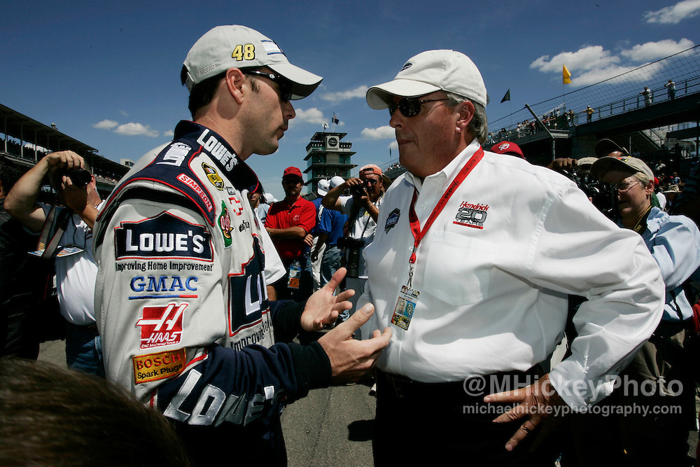 Points leader Jimmie Johnson and car owner Rick Hendrick talk on pit road during qualifications
