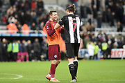Jay Lynch of Rochdale AFC speaks with Andy Carroll of Newcastle United after the The FA Cup third round replay match between Newcastle United and Rochdale at St. James's Park, Newcastle, England on 14 January 2020.