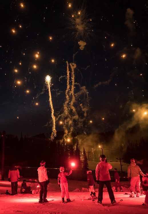 Fireworks fill the sky, following a torchlight parade on New Year's Eve at Monarch Mountain.