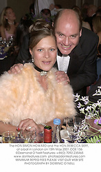 The HON.SIMON HOWARD and the HON.REBECCA SIEFF, at a ball in London on 15th May 2001.	OOE 156