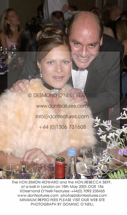 The HON.SIMON HOWARD and the HON.REBECCA SIEFF, at a ball in London on 15th May 2001.OOE 156
