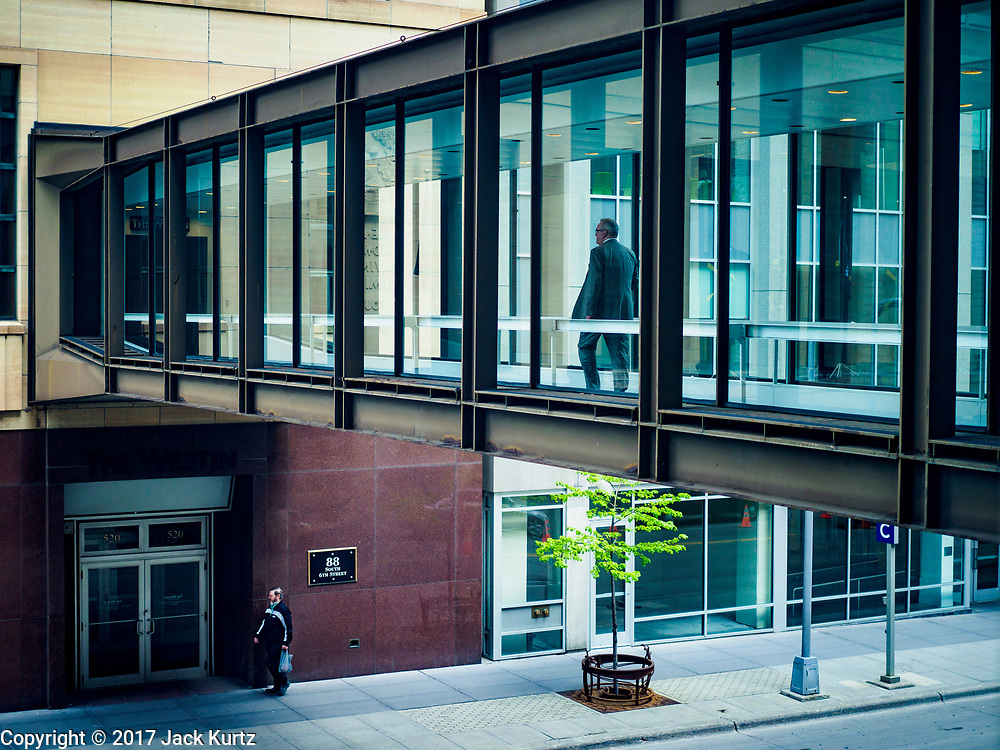 03 MAY 2017 - MINNEAPOLIS, MN: The skyway going into the Soo Line Building, a historic building renovated into upscale apartments. The skyways are enclosed pedestrian overpasses that connect downtown buildings. The Minneapolis Skyway was started in the early 1960s as a response to covered shopping malls in the suburbs that were drawing shoppers out of the downtown area. The system grew sporadically until 1974, when the construction of the IDS Center and its center atrium, called the Crystal Court, served as a hub for the downtown skyway system. There are 8 miles of skyways, connecting most of the downtown buildings from Target Field (home of the Minnesota Twins) to US Bank Stadium (home of the Minnesota Vikings). In the last five years many upscale downtown apartment buildings and condominium developments have been added to the system, allowing downtown residents to live and work downtown without going outside.    PHOTO BY JACK KURTZ