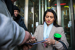 © Licensed to London News Pictures. 11/02/2018. London, UK. Former Secretary of State for International Development Priti Patel signs an autograph outside BBC Broadcasting House. Photo credit: Rob Pinney/LNP