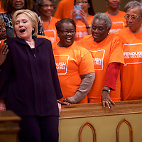FLORENCE, SC - FEBRUARY 25:  Democratic Presidential candidate, former Secretary of State Hillary Clinton reacts to a supporter's comments before posing for a photo with members of the Brady Campaign to Prevent Gun Violence group after holding a Breaking Down Barriers Town Hall with Senator Cory Booker February 25, 2016 at the Cumberland United Methodist in Florence, South Carolina.  The South Carolina Democratic Presidential Primary is on February 27.  Last Saturday, the South Carolina GOP Presidential Primary shattered records with 137,092 more votes cast than in any previous primary.  (Photo by Mark Makela/Getty Images) *** Local Caption *** Hillary Clinton