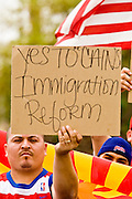 10 APRIL 2006 - PHOENIX, AZ: SELVIN SUCHITE, an undocumented immigrant from Guatemala who has been in the US for 20 years, demonstrates in favor of the immigration bill proposed by Arizona Sen. John McCain and Massachusetts Sen. Ted Kennedy during an immigration demonstration in Phoenix, AZ. More than 125,000 people participated in a march for immigrants's rights in Phoenix Monday. The march was a part of a national day of action on behalf of undocumented immigrants. There were more than 100 such demonstrations across the US Monday. Protestors were encouraged to wear white, to symbolize peace, and wave American flags, to demonstrate their patriotism to the US.  Photo by Jack Kurtz