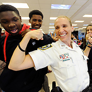 Hillsborough County School Resource Deputy Charity Arthur shares a laugh with 8th graders during lunch Wednesday, Dec. 10, 2014 at Sergeant Paul R. Smith Middle School in the Citrus Park area of Tampa. Deputy Arthur has donated money out of her own pocket to help needy students at the school.