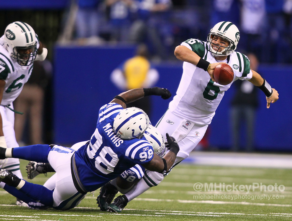 Jan. 08, 2011; Indianapolis, IN, USA; New York Jets quarterback Mark Sanchez (6) is under pressured and sacked by Indianapolis Colts defensive end Robert Mathis (98) and Indianapolis Colts defensive tackle Eric Foster (68) during the 2011 AFC wild card playoff at Lucas Oil Stadium. Mandatory credit: Michael Hickey-US PRESSWIRE