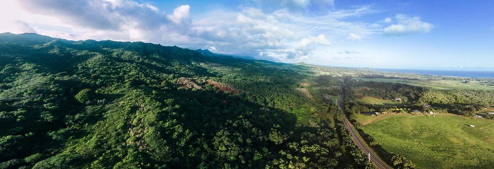 Aerial panorama photograph of Kuhio Highway skirting the Moloa'a Mountains, Kauai, Hawaii