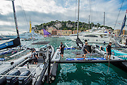 Emirates Team New Zealand cleaning up the Extreme 40 after the Extreme Sailing Series Practice day in Nice. 1/10/2014