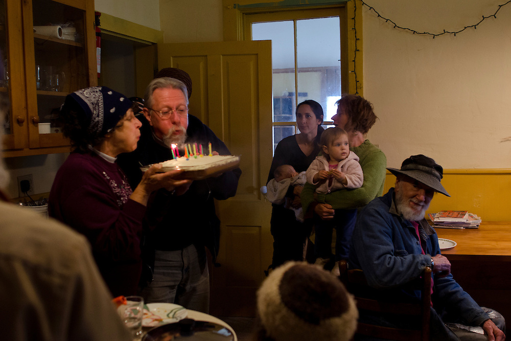 "Celebrating his birthday at the old house with the community at Currents, Roger Wilkens says, ""We have created a model of how to do cooperative community and we are still learning a lot. We have a model other people can replicate. And I think as a community we are successfully doing a generational transition right now. The continual existence of the community is generally assured. And as a community we are going to go on for a long, long time. I have thoroughly enjoyed all the years I've lived here."""