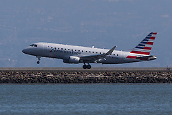 American Eagle Embraer ERJ 170-200 LR (N210NN) lands at San Francisco International Airport (SFO), Millbrae, California, United States of America