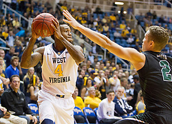 Nov 20, 2015; Morgantown, WV, USA; West Virginia Mountaineers guard Daxter Miles Jr. looks to pass around Stetson Hatters guard Grant Lozoya during the first half at WVU Coliseum. Mandatory Credit: Ben Queen-USA TODAY Sports