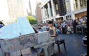 """Musician Tara Kamangar performs during a day of free concerts as part of the celebration of """"Art for All"""" and the conclusion of Sing for Hope Pianos, supported by Chobani, Inc., at Lincoln Center, Sunday, June 16, 2013, in New York. (Photo by Diane Bondareff/Invision for Sing for Hope/AP Images)"""